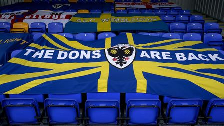 AFC Wimbledon flags in the stand before the Sky Bet League One match at Plough Lane, London. Picture