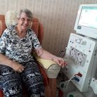 Linda Charge and a dialysis machine being used at home