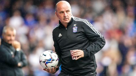 Town manager Paul Cook retrieves the ball during the game.