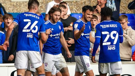 Town players celebrate with Wes Burns after his goal had taken them 2-0 up.