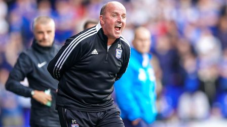 Town manager Paul Cook screaming instructions from the touchline.