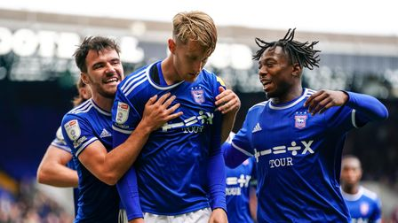 Scott Fraser and Kyle Edwards celebrate with Joe Pigott after he had given them the lead from the pe