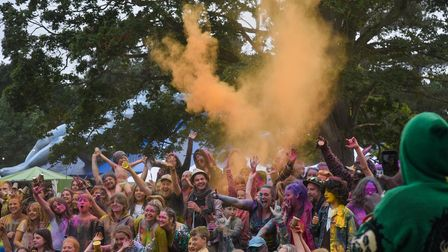 Festival goers playing with powder paint at Maui Waui Festival in Gressenhall. Picture: Danielle Boo