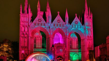 The magnificent west front of Peterborough Cathedral is lit by a new state-of-the-art LED lighting s