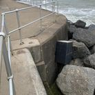 Vandals have hurled North Norfolk District Council's concrete bins from Sheringham prom.