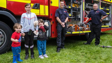 Three children stand in front of an Essex County Fire and Rescue Service engine in Easton