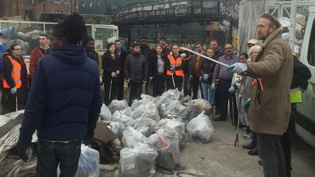 Volunteers recruited by McDonald's fast food chain help tidy up around Bethnal Green
