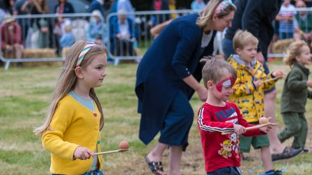 Children take part in an egg and spoon race at the Countess of Warwick's Show, Essex