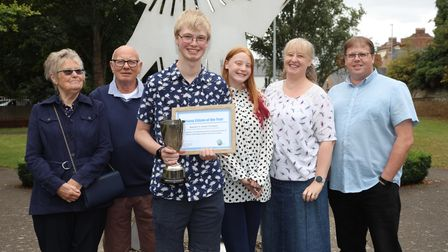 Young Citizen of the Year, Joseph Thompson (pictured) and his family with his award.