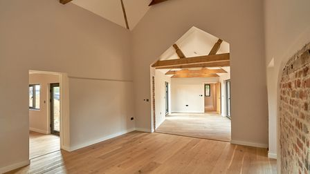 Large reception rooms with oak floors, exposed brick and flint walls and huge vaulted ceilings with exposed beams