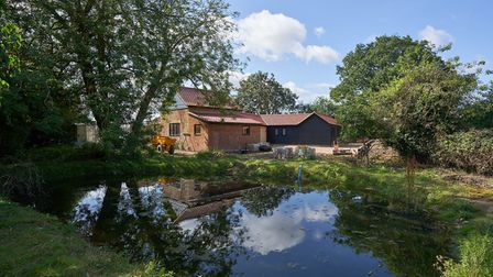 Brick and flint barn conversion in large one acre plot in Suffolk countryside with natural pond