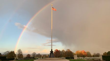 Rainbows over the flagpole at Cambridge American Cemetery