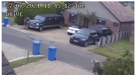 CCTV captured in July of a black Ford Limo (left) parked at Mr Thompson's home