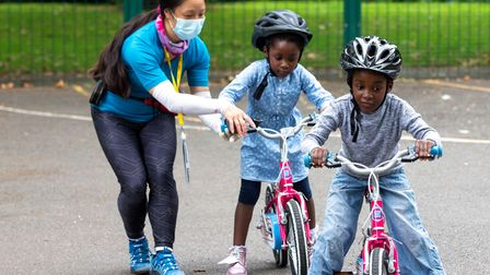Helping hand... getting kids used to cycling