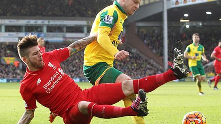 A penalty is awarded to Norwich by referee Lee Mason after Alberto Moreno of Liverpool fouls Steven