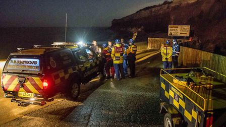 Emergency services discuss what action to take. Picture: Matthew Usher.