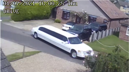 A white stretched limo leaving Chadacre