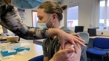 Ipswich Town winger Wes Burns has his Covid-19 vaccination