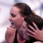 Great Britain's Bethany Firth (right) celebrates winning gold with Jessica-Jane Applegate who won br