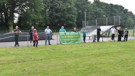Volunteers from North Walsham Play charity in front of what will be the new Trackside Park skatepark in North Walsham.
