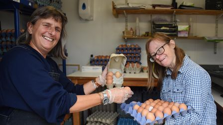 Volunteer Sari Kelsey, left, and Sam Howell, sorting the eggs at Clinks Care Farm, Toft Monks, who a