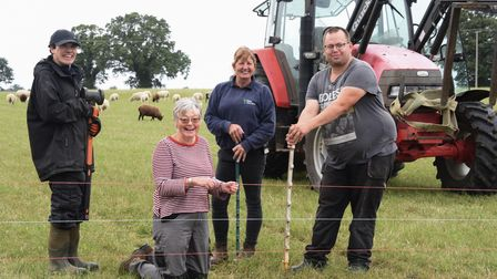 Iris van Zon, front, farm manager, with Pam Reynolds, support worker; and farm workers, Ashley Fergu