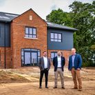 Justin Coote, Simon Muirhead and Rob Lockhart, three property developers stood in front of new build home