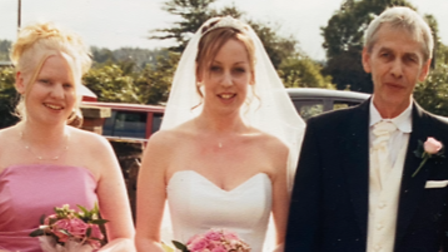 Malcolm with his two daughters, Laura (centre) andLeanne (right) on Laura's wedding day.