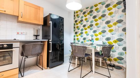 Kitchen/diner with seating and electric oven at a converted granary building for sale in Hingham, Norfolk