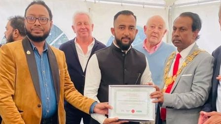 Muhi Mikdad receiving his people's award from Speaker of Tower Hamlets CouncilMohammed Hossain