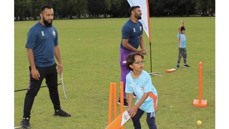 Muhi keeping wicket at the summer cricket festival he held for children at Victoria Park