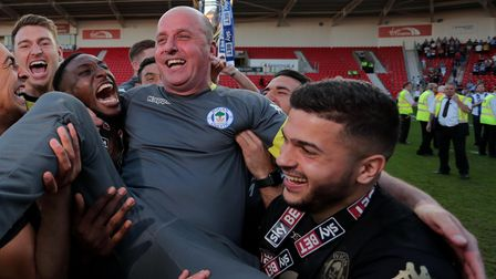 Paul Cook and Sam Morsy celebrate winning the League One title at Wigan