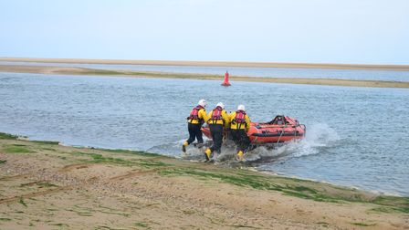 Wells RNLI were called to rescue four people stuck on a spit of sand off the beach.