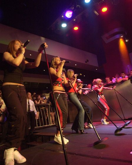 Girls Aloud playing performingat Time nightclub in Norwich in 2004, withSarah Harding on the right.