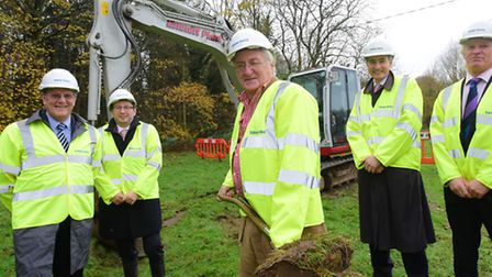 Norfolk County Council leader George Nobbs (centre) cuts the turf to officially start the constructi