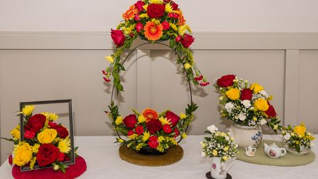 Red, yellow and orange flowers on display at Dunmow Horticultural Society's Autumn Exhibition, Great Dunmow, Essex