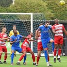 Barking defenderJay Leader wins a header against Ilford in the FA Cup