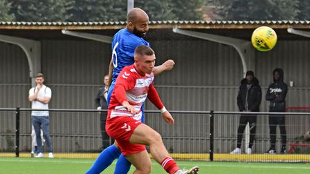 Barking captainElliot Omozusi wins aheader against Ilford in the FA Cup