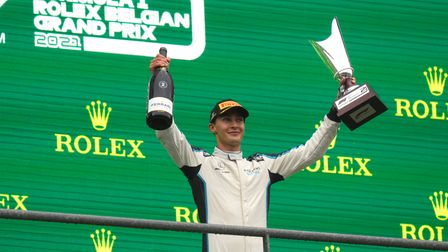 George Russell celebrates his first podium finish at a bizarre Belgian Grand Prix