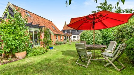 The house comes with stunning grounds and lawns with a large summer house
