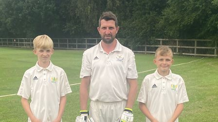 The Millbank family with 13-year-old Alex (left) and 11-year-old Zack (right) either side of dad Graham.