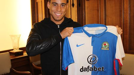 Elliott Bennett shows off the new shirt he'll be wearing. Picture: ROVERS.CO.UK