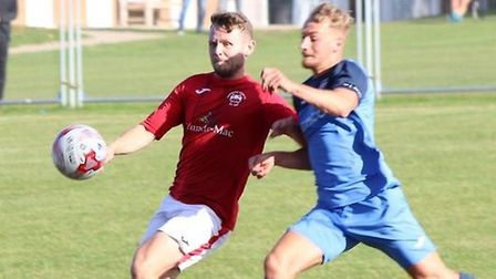 Ely City in action with Downham Town in the FA Vase