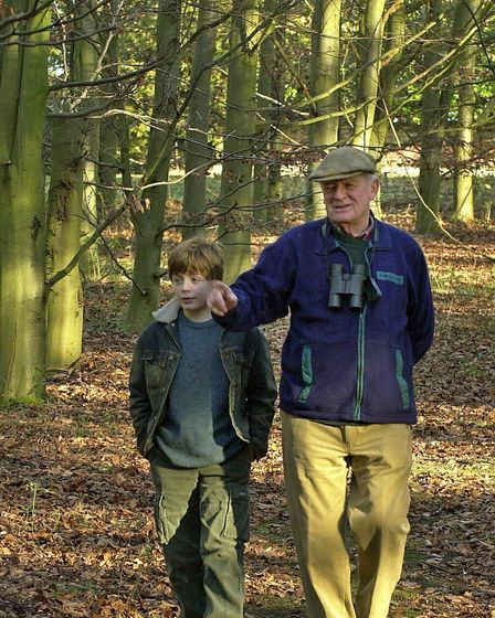 Sir Timothy Colman enjoys one of his passions, spending time with his family, here walking with gran