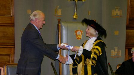 Sir Timothy Colman is presented with a scroll to mark his honorary freedom of the City by the Lord M