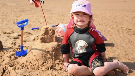 Two-year-Mia White making sandcastles in the hot weather at Wells-next-the-Sea. Picture: DENISE BRAD