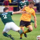 Josh Burrows in action for March Town