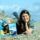 May De La Rue recreating a picture taken 11 years ago when she completed a 50-mile walk with her dad on the Suffolk coast