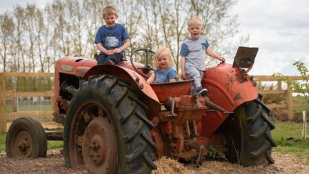 Elliott, Evelyn and Laurie having fun on the tractor on the Hollow Trees Farm Trail.