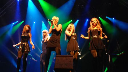 Girls Aloud in concert at Holkham Hall in 2007, with Sarah Harding centre.